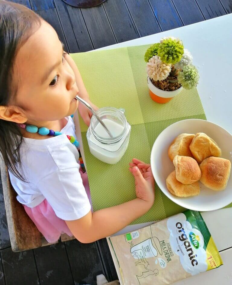 Kid drinking Arla Organic Powdered Milk