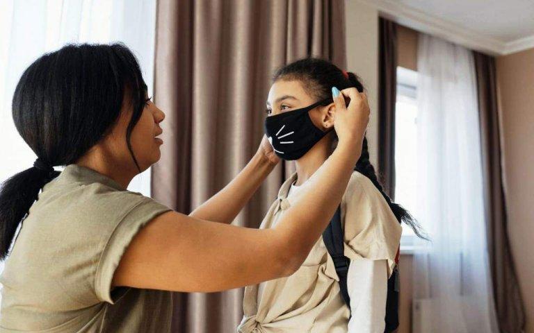 kid wearing face mask